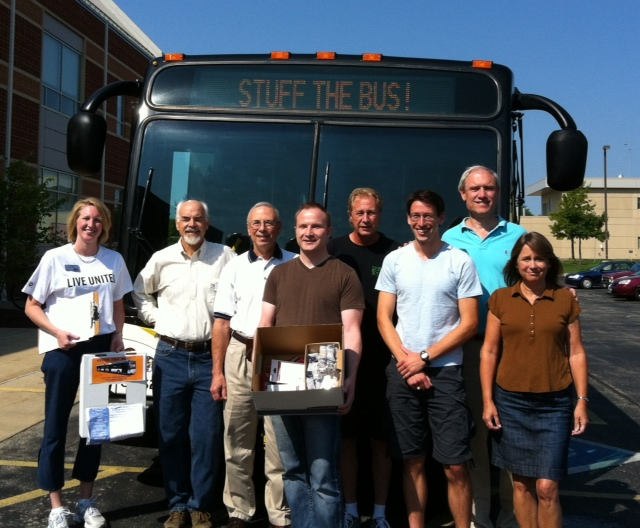 """Aqueous Solutions, United Way employees, Celebrity """"Stuff the Bus"""" riders at EnterpriseWorks"""