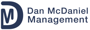 Dan McDaniel Management_Navy logo