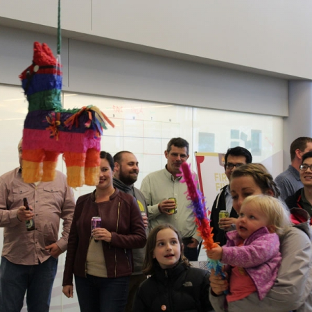 Kids playing with a Pinata